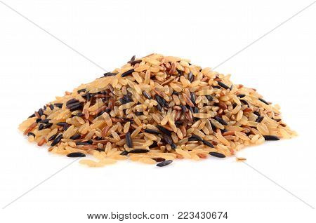 Pile of brown wild rice isolated on white background