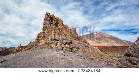 View of rocks and volcano Teide  in Teide national park on Tenerife. Copy space in sky.