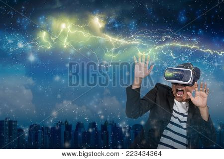 Double exposure of Asian man wearing virtual reality in scared action Looking the thunder lightnings over star with the cityscape background, VR concept, 3D illustration