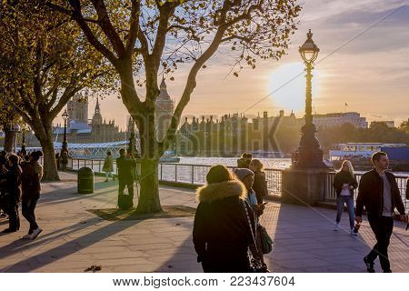 LONDON, UNITED KINGDOM - NOVEMBER 07: Thames riverside walking path in Central London during sunset on November 07, 2017 in London