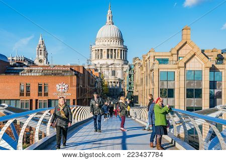 LONDON, UNITED KINGDOM - NOVEMBER 06: View of the famous Millenium Bridge and St Paul's catherdral on November 06, 2017 in London