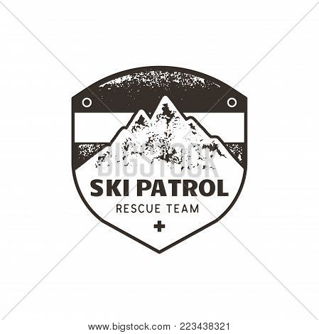 Vintage hand drawn mountain ski patrol emblem. Rescue team patch. Mountains stamp. Monochrome, grunge letterpress effect. Stock vector retro badge illustration isolated on white background.
