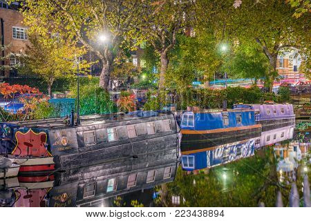 LONDON, UNITED KINGDOM - OCTOBER 31: Night view of boats and nature in the famous Little Venice waterway on October 31, 2017 in London