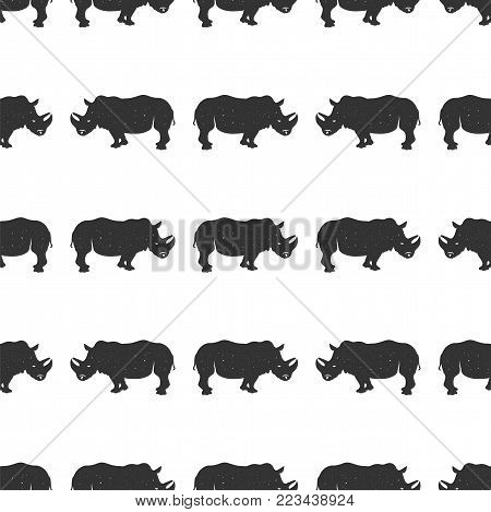 Rhino seamless. Wild animal wallpaper. Stock vector rhinoceros pattern isolated on white background. Monochrome Vintage hand drawn design.
