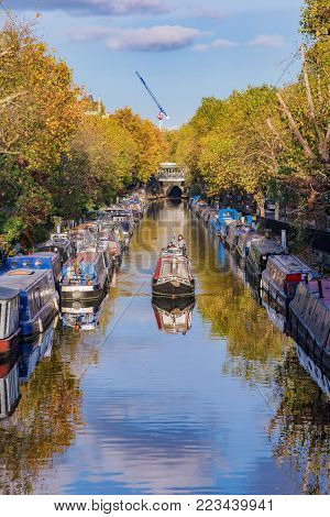 LONDON, UNITED KINGDOM - OCTOBER 31: Boats in the famous Little Venice along the Regents Canal waterway on October 31, 2017 in London