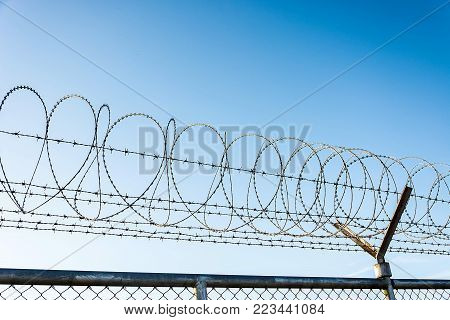 Barbed Wire Fence Used For Protection Purposes Of Property And Imprisonment, No Freedom, Barbed Wire