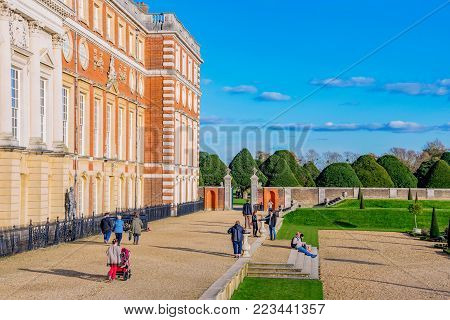 LONDON, UNITED KINGDOM - OCTOBER 28: Gardens and architecture of Hampton Court Palace, a historic landmark in the Richmond area on October 28, 2017 in London