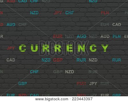 Currency concept: Painted green text Currency on Black Brick wall background with Currency