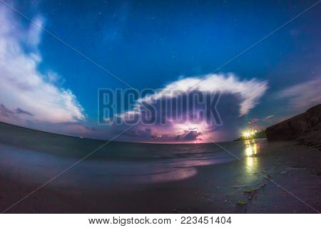 Beautiful nightscape with storm clouds and thunderbolts over the Black Sea,Tuzla, Romania