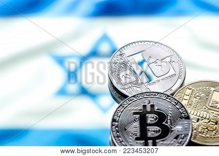 coins Bitcoin and litecoin, against the background of the Israeli flag, concept of virtual money, close-up. Conceptual image of digital crypto currency.