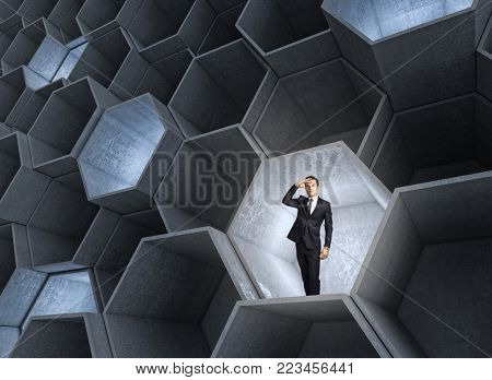 standing businessman in 3d abstract hexagon structure