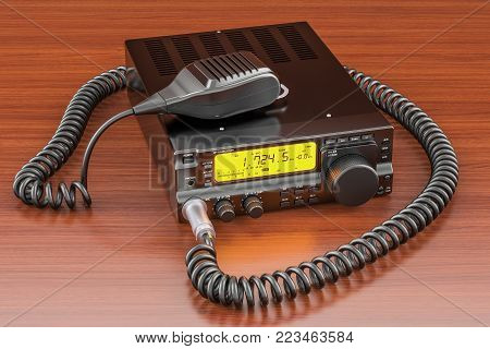 Amateur radio transceiver with push-to-talk microphone switch on the wooden table. 3D rendering