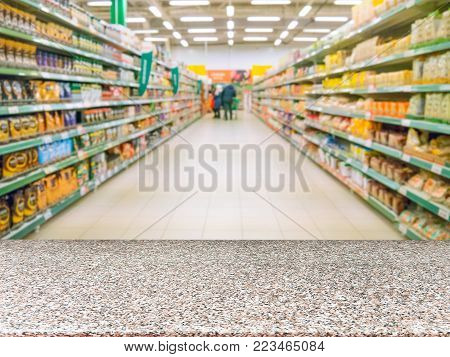Marble board empty table in front of blurred background. Perspective table over blur in supermarket - can be used for display or montage your products. Mockup for display of product.