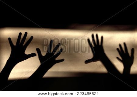 Abstract Background. Black Shadows Of A Hands On The Wall. Silhouette Of A Hands On The Wall. Nightmares in Children. Scary Dreams.Hands Silhouette. poster