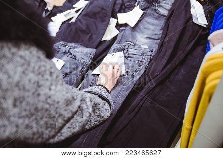woman seek new sweater in the mall