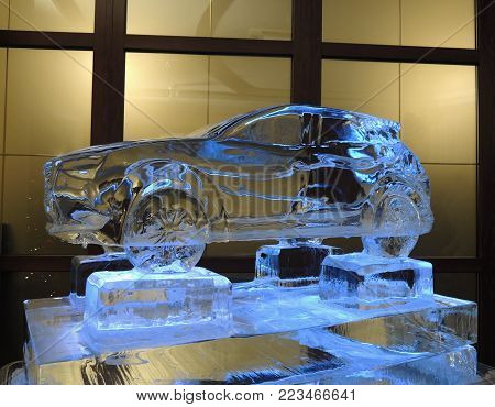 The Ice Sculpture Of Vehicle On The Ice Pedestal