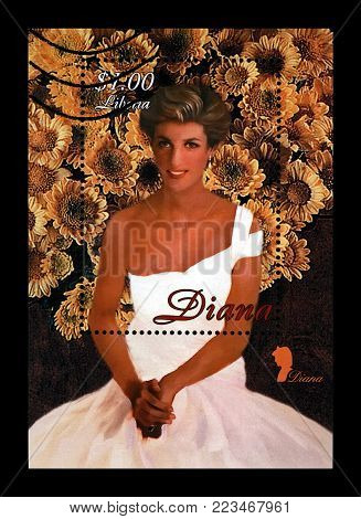 LIBERIA - CIRCA 1997: canceled stamp printed in Liberia dedicated to the memory of princess Diana, circa 1997. vintage post stamp isolated on black background.