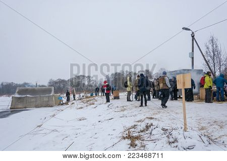People Stand In The Bathing Place At The Epiphany Of The Lord 01.20.2018 In The Village Of Dunilovo,