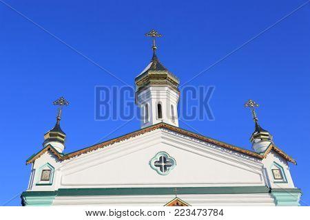 Semenovsky Church cupola on blue sky background. Exaltation of the Cross Monastery in Poltava, Ukraine.