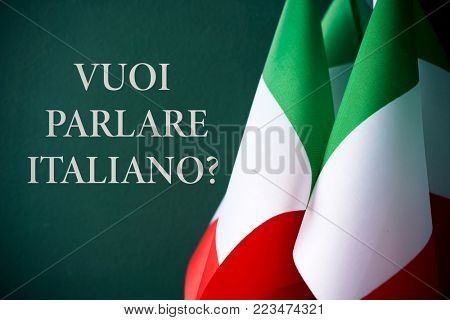 some flags of Italy and the question voi parlare italiano?, do you want to speak Italian? written in Italian, against a dark green background