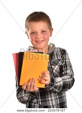 A teenager with books. A boy is studying in a school. A boy's portrait. A cheerful boy. A good mood.