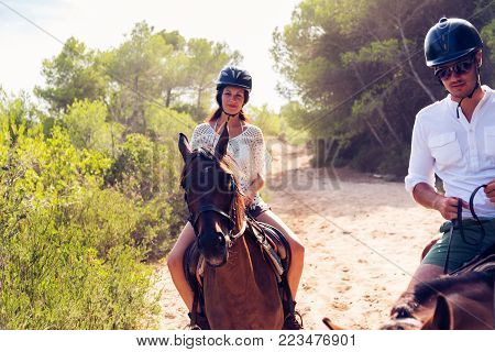 Young tourists horseback riding in Mallorca, Spain