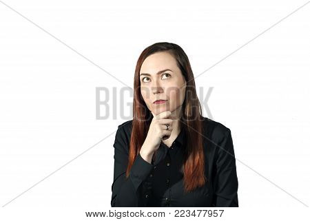 girl on a white background with an expression of deep reverie on her face