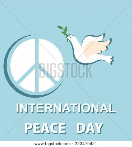 Greeting pastel blue card with paper cut out dove and peace symbol for International Peace day