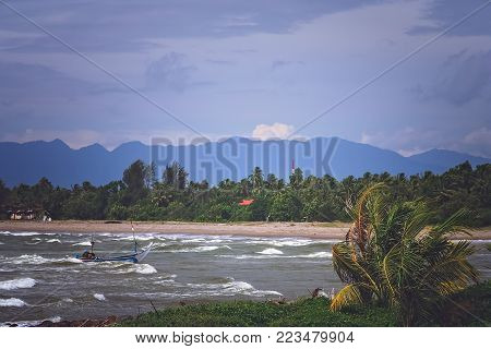Fisherman returning to the beach after days work on a rough seas on the coast of Sumatra Island, Indonesia, Asia