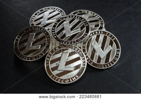 Heap of silver litecoins. Real photo. Virtual crypto currency concept.  High class luxury background.