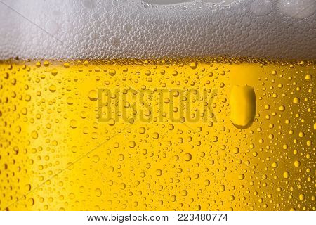 A closeup from a beer glass with oxygen bubbels. ideal for websites and magazines layouts