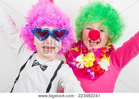 two little happy children with carnival mask