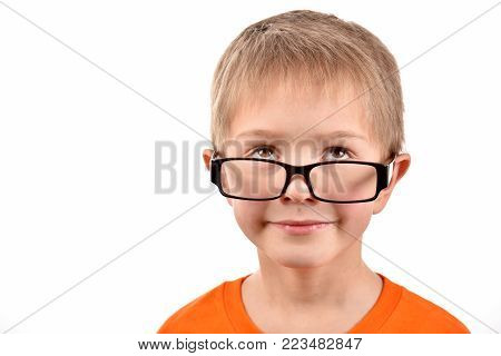 A boy in glasses. Portrait of a boy. A cheerful boy. Good mood.