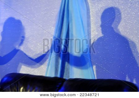 the shadow of men and women in blue tones
