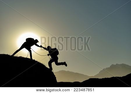 team together ,achieve & support and mountaineering activity