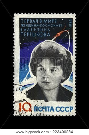 USSR - CIRCA 1963: canceled stamp printed in USSR (Soviet Union) shows Valentina Tereshkova, soviet astronaut, 1st woman in the space, rocket shuttle, circa 1963. vintage post stamp on black background.