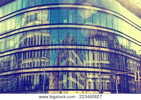 BERLIN, GERMANY - SEPTEMBER 17, 2017: City architecture reflected in glass facade windows of Galeries Lafayette Berlin building. This building of French architect Jean Nouvel is also called Quartier 207