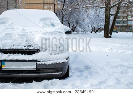 Parked Car Covered With Snow - Snow Storm, Car After A Heavy Snowfall, A Lot Of Snow On The Car, Car