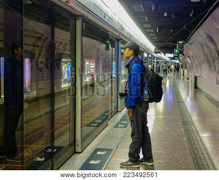 Hong Kong - Mar 29, 2017. A Man Waiting At Subway Station In Hong Kong. In 2014, Hong Kong Was The E
