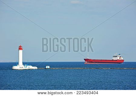 Bulk Carrier Near Lighthouse