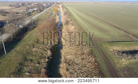 The channel of the lower level of the irrigation system of fields. Infrastructure for the cultivation of rice.