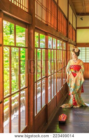 Kyoto, Japan - April 28, 2017: woman in geisha makeup posing inside Eikan-do Temple or Zenrin-ji belongs to the Jodo sect of Japanese Buddhism. Eikando is near the southern end of Philosopher's Path.