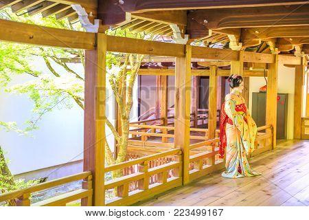 Kyoto, Japan - April 28, 2017: woman in geisha makeup posing inside Eikan-do Temple or Zenrin-ji belongs to the Jodo sect of Japanese Buddhism. Eikando is a popular Zen Temple in Kyoto.