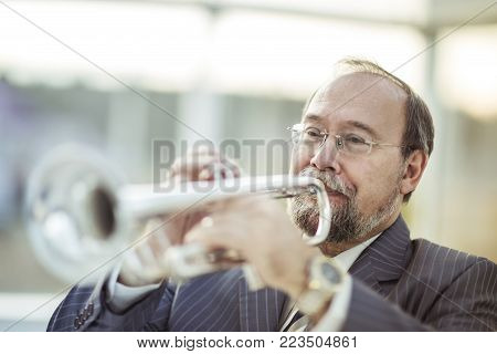 closeup of a musician with a pipe on a light background.the photo has a empty space for your text
