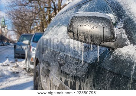 Thick layer of ice covering car after freezing rain in Montreal, Canada