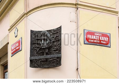 Prague, Czech Republic - March 19, 2017: Sculpture and street at the house where famous write Franz Kafka was born