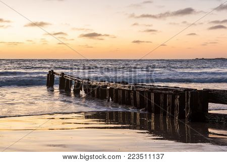 Sunrise Over The Groynes In Victor Harbor