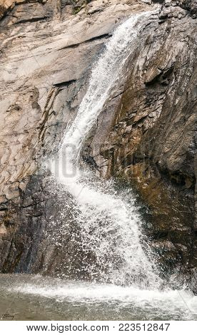 Water spraying from the lowest portion of Seven Falls in Colorado