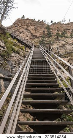 Colorado Springs, CO/USA - Circa September 2016: Looking up the stairs next to the waterfalls at Seven Falls in Colorado Springs, Colorado.