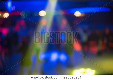 People Dance Sing Have Fun And Relax In A Night Club Blurred Background. Flashes Of Light Beautiful